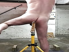 Slave's dildo behind the scenes