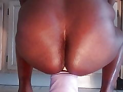BlackAmazonCD riding a fat dildo bald
